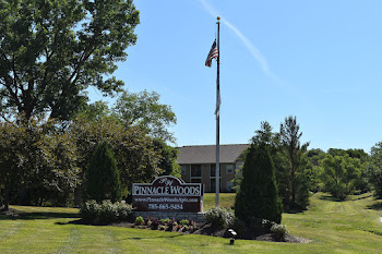 Go to Pinnacle Woods Apartment Homes website