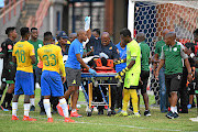 An injured Letlabika is carried away in a stretcher.