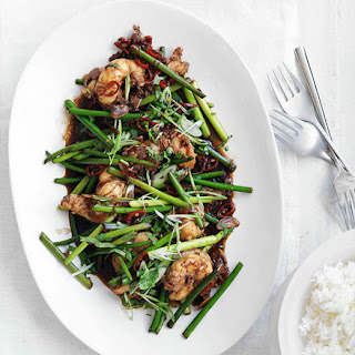 Stir-fried lobster with Sichuan pepper and garlic stems.