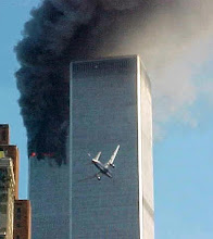 Photo: United Airlines Flight 175 approaches the south tower of the World Trade Center in New York shortly before collision as smoke billows from the north tower.