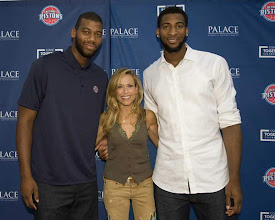 Photo: Pistons Greg Monroe, left, and Andre Drummond pose with singer/songwriter Sheryl Crow at the Palace/Pistons Come Together Celebration on Sunday at DTE Energy Music Theatre. Allen Einstein/Special to the Free Press
