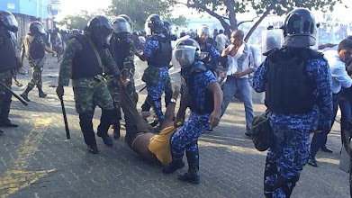 Photo: MP, Thinadhoo, Mohamed Gasam dragged by Police on February 7th