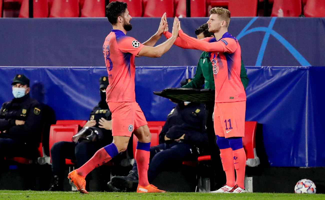Olivier Giroud and Timo Werner of Chelsea high five as they swap in a substitution - Photo by David S. Bustamante/Soccrates/Getty Images
