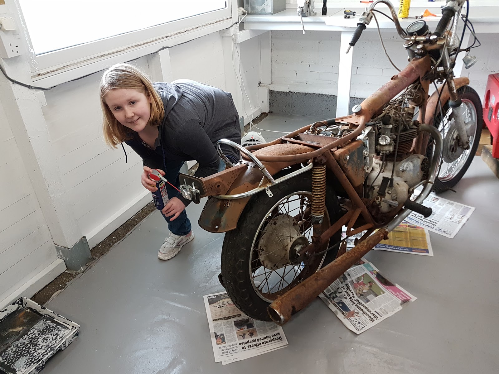 Stripping down a rusty Triumph Bonneville T120 project in the workshop.