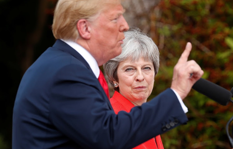 US President Donald Trump and British Prime Minister Theresa May hold a press conference after their meeting at Chequers in Buckinghamshire, Britain on July 13 2018. Picture: REUTERS/KEVIN LAMARQUE