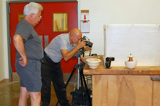 Photo: Jeff Tate learns some tricks from Mike Colella as he photographs the Show & Tell pieces.