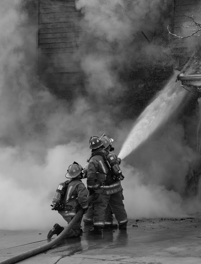 Putting Out the Fire by Gerald Glaza - People Professional People ( water, junctioncity, firefighters, firstresponders, fortriley, kansas, smoke, fire,  )