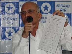 Photo: Member, IEA displaying the Ballot Paper