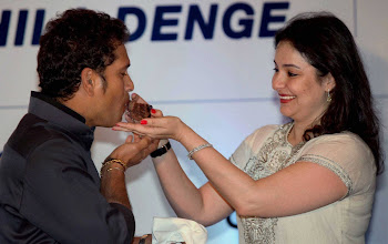 Photo: Kolkata: Cricketer Sachin Tendulkar is offered a piece of a cake by his wife Anjali during his 40th birthday celebration  in Kolkata on Wednesday. PTI Photo by Ashok Bhaumik (PTI4_24_2013_000026A)