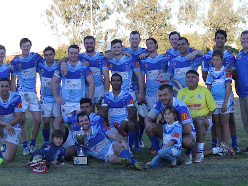 John 'Dallas' Donnelly Trophy Winners: Narrabri Blues with the trophy after their 26-18 derby win over rival Gunnedah Bulldogs on Sunday afternoon. Back, Dylan Gale, Toby Bentley, Norman Lawler, Sam Sadler, Daniel Howe, Jacob Nichols, Jed Smith, Brodie Rumsby, Nathan Harvey, Robert Condran, supporter Jamal Clarke, manager Steve Page, front, Shannon Swan, supporter Isaac Hynch, Stanley Binge, Lachlan Cameron, Kialu Brown, Andrew Harvey, supporter Mckenzie Harvey and trainer Terry Hynch.