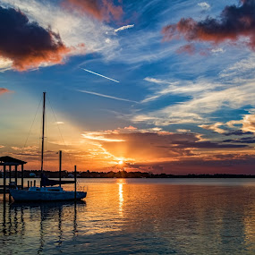Back Bay Biloxi Beauty by Don Young - Landscapes Sunsets & Sunrises ( landscapes, sun rays, waterscape, sunset, clouds, boat )