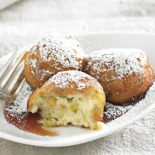 Ricotta Pistachio Fritters with Lemon Syrup.