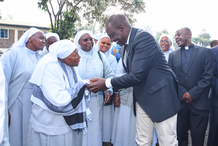 Deputy President William Ruto interacting with Sisters of Maria Immaculata Education centre during the celebration of Holy Mass at the school's ground, Kiamumbi, Kahawa West, Kiambu county.
