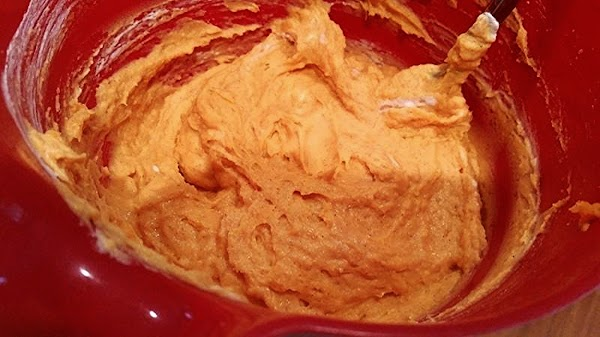 Set aside to cool, about 5 minutes. Fold in half the tub of cool...