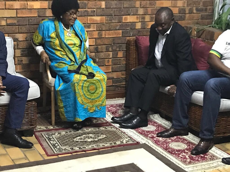 Winnie Madikizela-Mandela wore a striking blue patterned' loose flowing gown for the meeting led by new ANC president Cyril Ramaphosa at her Orlando house.