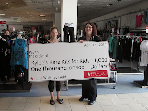 Photo: Sarah Morand presenting Kylee with the $1000 Grant from Macy's