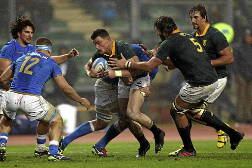 Forging ahead: Jesse Kriel takes on the Italy defence with back-up from Lood de Jager, No5, and Bok captain Eben Etzebeth in the 35-6 win over the Azzurri in Padua on Saturday. Picture: GABRIELE MALTINTI/GALLO IMAGES