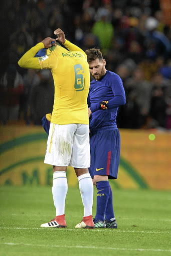 Lionel Messi and Wayne Arendse of Mamelodi Sundowns exchange jerseys.