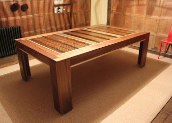 Spartan dining table with dark wood in a loft