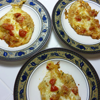 Baked Purple Aubergines Pizzas with Silana Provola Cheese, Cherry Tomatoes and Capers.