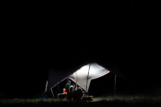 Photo: Night time scene - the mess tent - working late.
