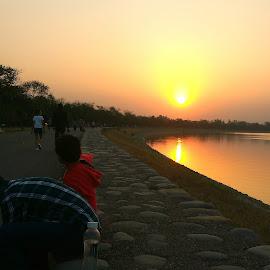 Sun sinking by Abhijit Medhi - City,  Street & Park  Street Scenes ( mobile photo, sunset, lake, water, landscape )