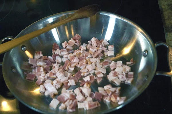 Add the bacon to a pan, over medium heat.