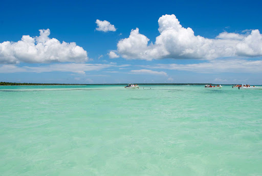 Snorkeling-Dominican-Republic - Snorkelers and pleasure craft in a lagoon in the Dominican Republic.