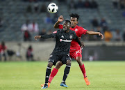 Augustine Mulenga of Orlando Pirates shields ball from Luckyboy Mokoena of Highlands Park during the Absa Premiership 2018/19 match between Orlando Pirates and Highlands Park at the Orlando Stadium, Soweto on 04 August 2018.