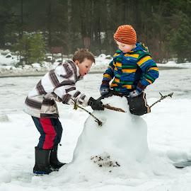 Making A Snowman by Garry Dosa - Babies & Children Children Candids ( snowman, outdoors, children, snow, winter, boys, people, fun )