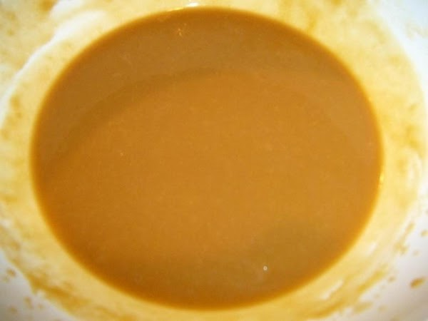In a medium bowl, pour the pudding mixes, milk and Kahlua. Whisk until thick.