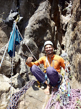 Photo: Richard Keher posing while transfering gear for the summit pitch (P4). He was obviously already pretty psyched to have made it this far!