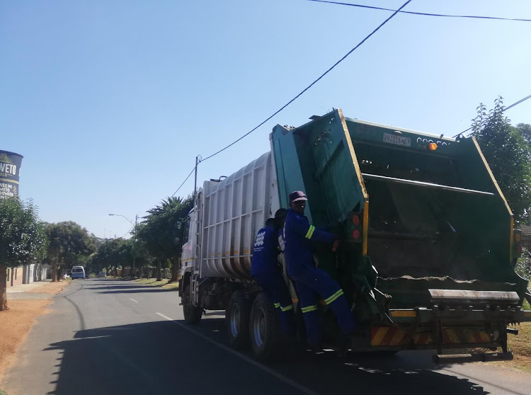 It was work as usual for Joburg's Pikitup team. Thokozani Mjoli, a garbage collector, said he was thrilled to be considered an essential services worker who 'served the country, no matter what'.
