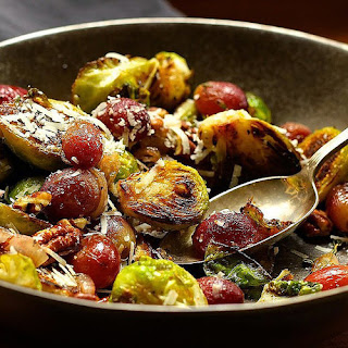 Pan-Charred Brussels Sprouts With Roasted Grapes, Pecans, and Pecorino
