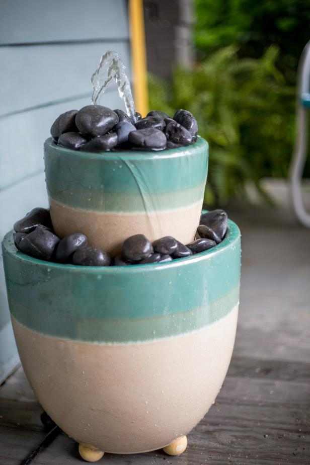 Pots with rocks turned into a water feature.