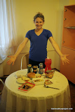 Photo: Liz shows off our fancy dinner spread: Ramen, instant potatoes, bread, cheese, and beer