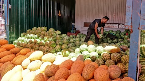 Piles of melons.