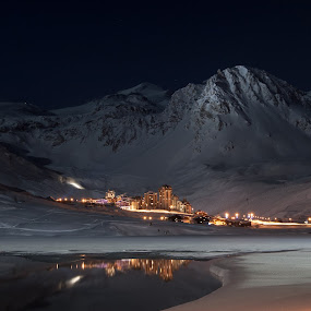 Val Claret at night by Max Mayorov - Landscapes Mountains & Hills ( europe, mountain, shine, sparkle, valley, landscape, reflexion, recreation, alpine, city, lights, tranquil, sky, sunny, snow, trail, above, resort, france, glitter, night sky, alps, ski, building, val claret, tignes, beautiful, cloudscape, scenic, holiday, from the top, vacation, winter, european, season, ski resort, lift, cloud, night, down, town, small )