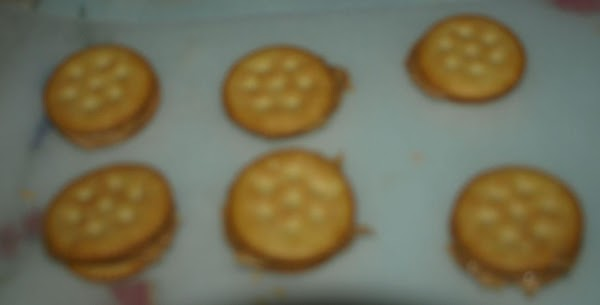 """Make your """"cookies"""" by placing peanut putter on the cracker and top with another..."""
