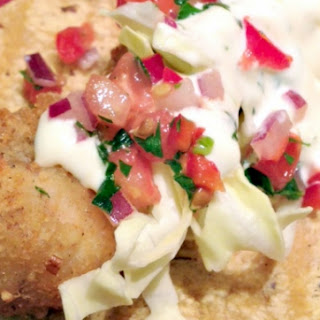 Pecan-Crusted Catfish Tacos with Meunière Aioli and Spicy Tomato and Herb Salsa.
