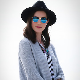 A Sense Of Fashion by Garry Dosa - People Portraits of Women ( sunglasses, modeling, woman, blue, outdors, person, black, hat, autumn, female, fashion )