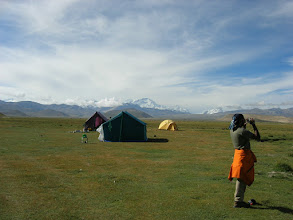 Photo: Surech on a day hike outside of Tingri. Cho Oyu can be seen behind the tents.