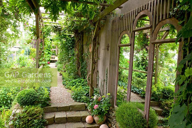 Recycled window frames used as a garden feature. A frame at the end of the path offers more mystery. Can you find a mirror used here?