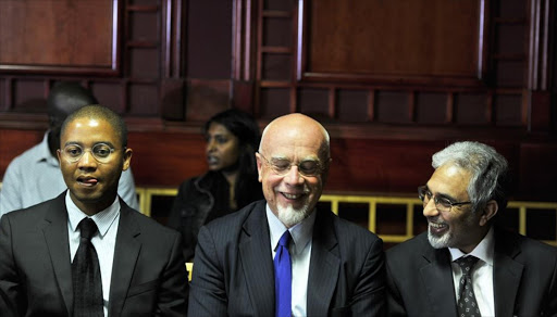 Yolisa Pikie, Peter Richer and Ivan Pillay appear at the Labour court on December 17, 2014 in Johannesburg, South Africa.