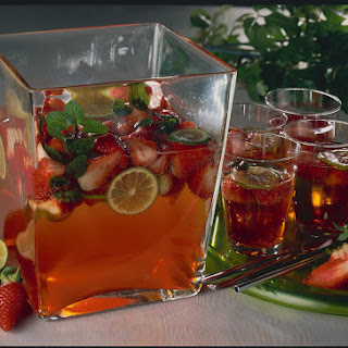 Hard Cider and Aperol Punch with Strawberries and Mint.