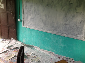 Photo: painting the room. we converted one of the classrooms (provided by the School) to a Peace Innovation Lab.