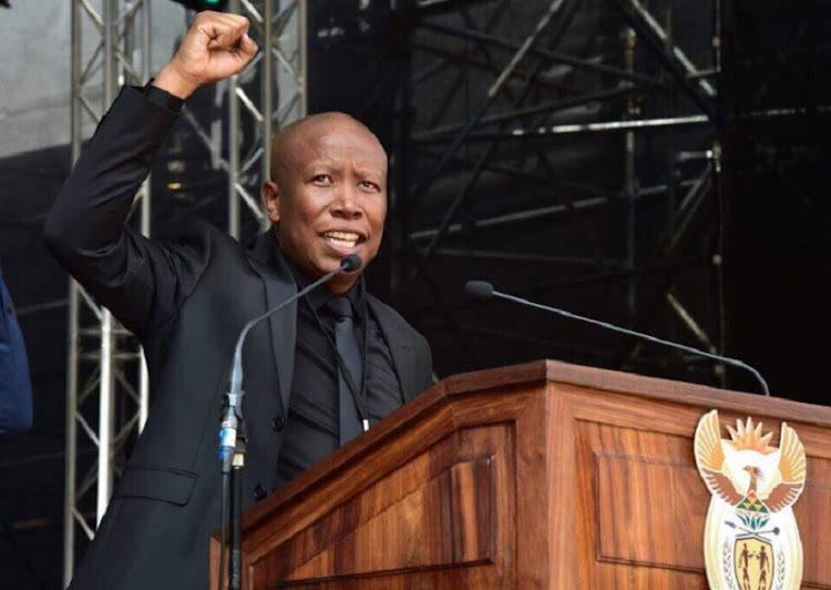 EFF leader Julius Malema speaks to mourners during the funeral service of Winnie Madizizela-Mandela at Orlando Stadium in Soweto.
