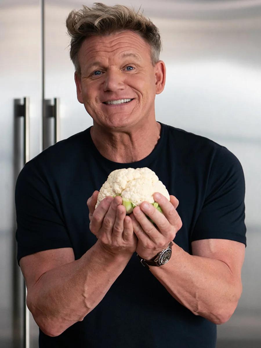Gordan Ramsay holding up a ball of cauliflower