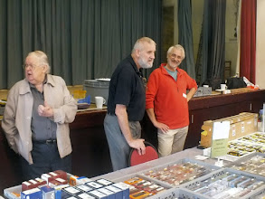 Photo: 010 At the other end of the hall, the 009 Society just put everything on the same table! David Camis, Lee Bryant and Brian Ellsmore all seem to be happy with the way things are going .