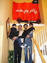 Photo: Zulfiqar, Iqbal, Irtiza and Qais at Ali Rizvi's residence under piece of Hazrat Abbas Ghazi's flag once raised at His Roza-e-Mubarrak.